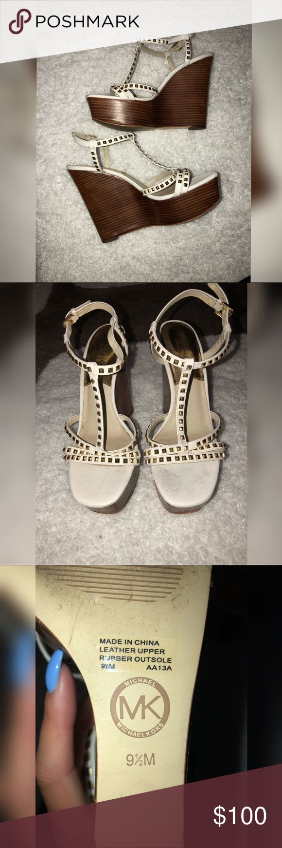 Michael Kors Wedges Michael Kors white with gold studded wedges. Very comfortable. Super cute for weddings and summer :)   ** will be professionally cleaned by shoe store, receipt will be included. Michael Kors Shoes Wedges