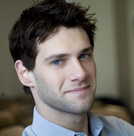 Justin Bartha. Black hair and BRIGHT blue eyes. Mmmmmm.