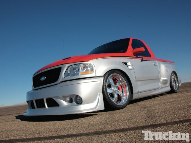 99 Ford SVT Lightning. It's got a bumper similar to the Mustang Cobra R. The fender vents give this truck a modern/custom look.