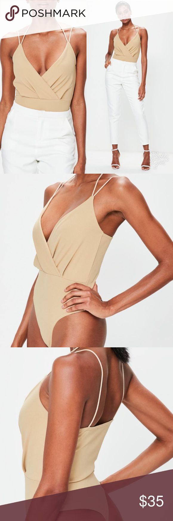 """Nude Bodysuit New with tags! Never worn. Selling due to the color not flattering with my skin tone. Regular fit - popper fasten at the gusset, 95% polyester 5% elastane. Approx length: 64cm/25"""" (based on a uk size 8 sample). The model wears a uk size 8 / eu size 36 / us size 4. Size of item being sold is a size 4. No stains or tears. Comes from a smoke-free home. Missguided Tops"""