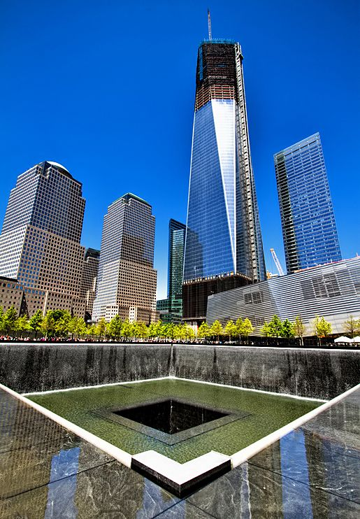 The Liberty Tower, officially the tallest building in New York City overlooking the Ground Zero Memorial.