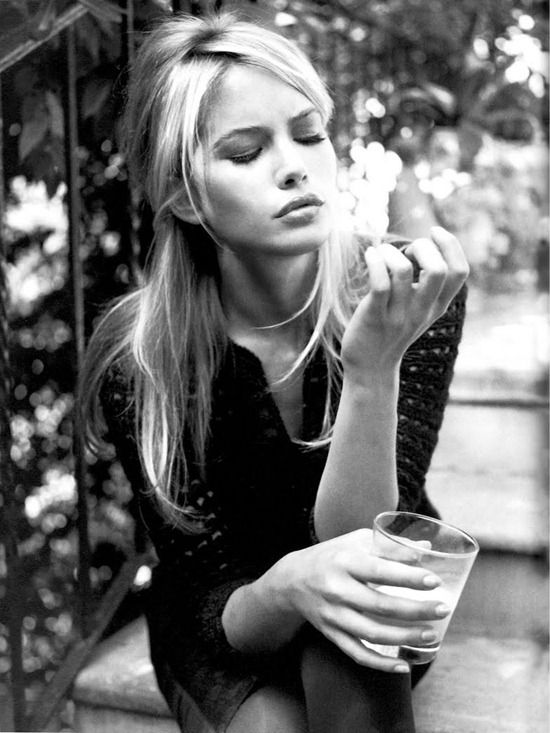 A modified, strangely parted Bardot bang: Valeria Mazza in Vogue Italia 1997