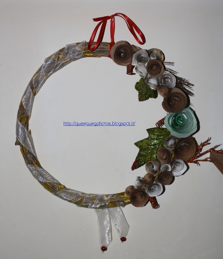 My first Wreath... made with soft wooden sticks,paper flowers,ribbons...Tutorial on my blog http://queequegphotos.blogspot.it/
