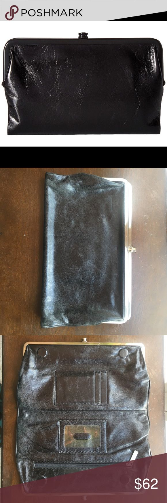 Hobo International Glory Clutch/Wallet This clutch is full of form & function: packs in a lot of details. Black leather is slightly distressed. Two kiss-lock pockets connect w/ magnetic closure in the center. Two exterior pockets: one is a large pouch for make-up or any other essentials & the other is a wallet with 8 slits for cards, one bigger slit for papers (cash, receipts, checks), and a zip-closure pocket. Between the two main kiss-locket pockets is space for an ID, more cards, and one more zip picket. Lined in a floral canvas. HOBO Bags Clutches & Wristlets