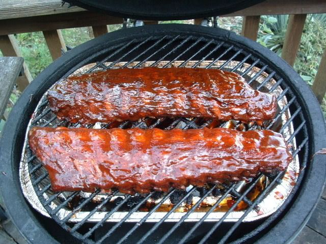 Baby back ribs on the BGE: apply rub and wrap in refrigerator for one hour, cook 4-5 hours min at 225, cook to 160 degrees at thickest part and until meet pulls way from end of rib. Let rest in foil for 15-30 min.
