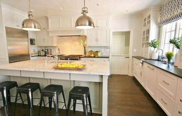 Elegant Honed Marble Subway Tile Decorating Ideas in Kitchen Traditional design ideas with Elegant barstool beige tile backsplash black countertop glass cabinet half door hidden range