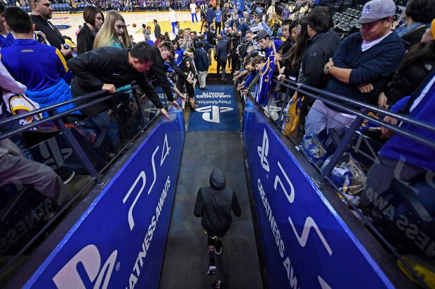 Golden State Warriors' Stephen Curry (30) exits the tunnel and runs onto the court before the start of their NBA game at the Oracle Arena in Oakland, Calif., on Saturday, Dec. 30, 2017. Curry returns to the floor tonight after sustaining an ankle injury on Dec. 4th. (Jose Carlos Fajardo/Bay Area News Group)