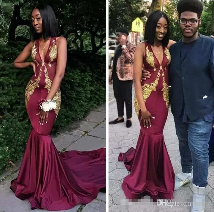 4b3246f7fce 2018 Arabic Burgundy Mermaid Prom Dresses Deep V Neck Sleeveless Gold Lace  Appliques African Evening Gowns
