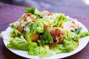 Classic Caesar Salad with romaine lettuce, homemade croutons, parmesan cheese, eggs and anchovies.