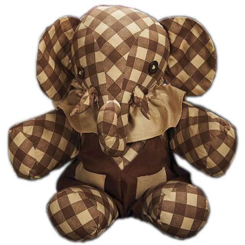Shirley Temple's very own toy elephant, from her playroom. Made of brown and white checkered cotton fabric, the well-constructed 15'' baby elephant has a curled trunk, stitched-on tusks, brown button eyes, floppy ears, stitch-jointed arms and legs, and wears its original ruffled collar and brown playsuit with beige pockets. Circa mid-1930's. Lot includes a vintage photograph in which the toy elephant is seen. Well preserved, in near fine condition. From the Shirley Temple estate.