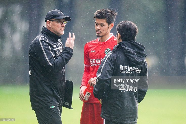 Head coach Thomas Schaaf of Hanover speaks to Hotaru Yamaguchi of Hanover during a friendly match between Hannover 96 and SV Wehen-Wiesbaden during Hannover 96 training camp on January 11, 2016 in Belek, Turkey.