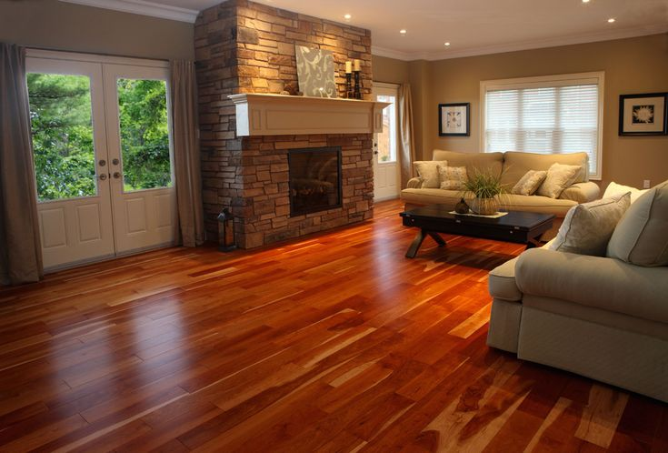 Floor Design, : Entrancing Living Room Decoration Using Red Cherry Black Hard Wood Flooring Including Light Brown Stone Fireplace Surround And Light Beige Brown Living Room Wall Paint