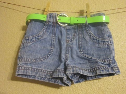 Circo brand size 24m Good regular jean shorts with  fun bright neon green belt included