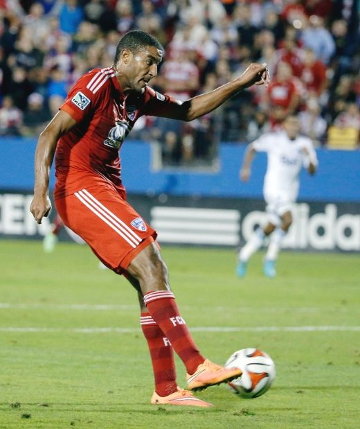 FC Dallas forward Tesho Akindele takes a shot, scoring against the Vancouver Whitecaps in the first half of an MLS playoff soccer match, Wednesday, Oct. 29, 2014, in Frisco, Texas.