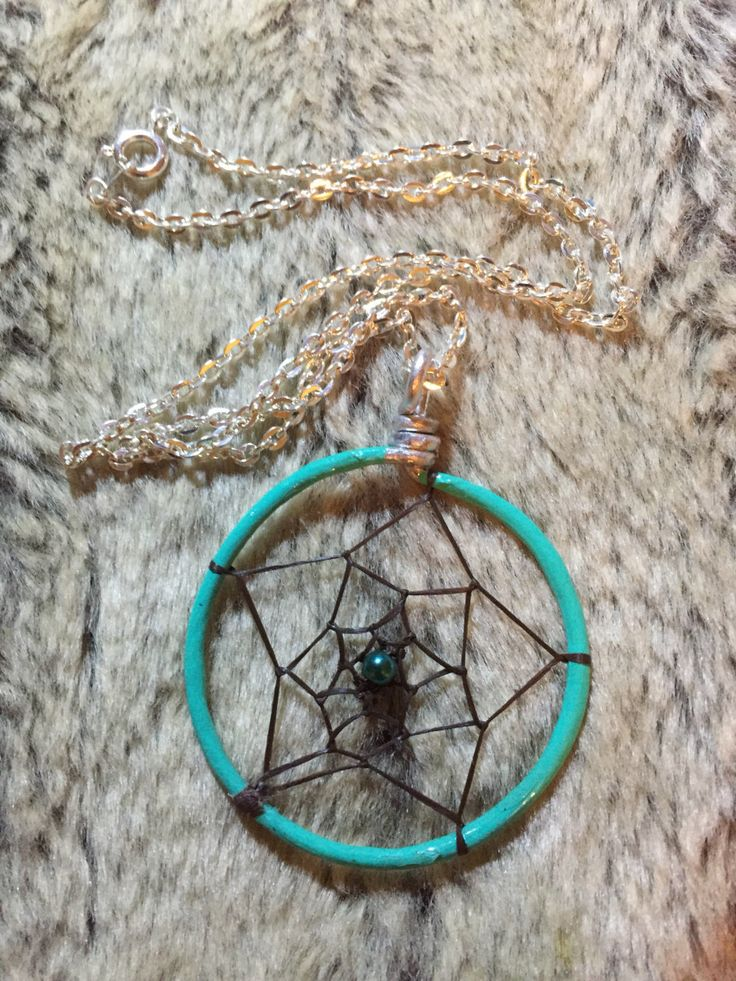 Hand wrapped, woven and painted teal turquoise dreamcatcher pendant woth teal dark turquoise glass pearl and 18' nickel free chain by EarthDiverCreations on Etsy https://www.etsy.com/ca/listing/483311658/hand-wrapped-woven-and-painted-teal