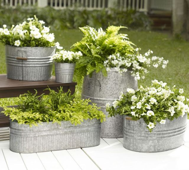 Galvanized Metal Tubs as Planters Drill several holes in the bottom and put in a layer of gravel before adding your soil and plants.  Once you drill holes in the bottom, use fingernail polish around the edges of the holes (inside & out) so the galvanized pots don't rust.