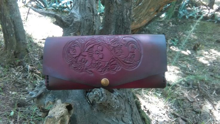 Leathercraft handmade leather purse with a skull and roses design tooled into it in a pink fades to black finish!