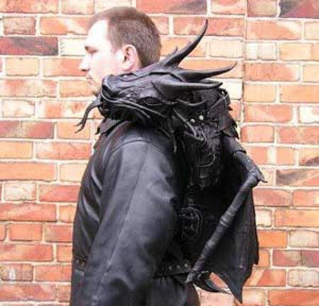Excuse me sir, there's a dragon on your shoulder. // Made by Bob Basset of Ukraine. Bob, who if you can't tell is a dragon fanatic, made the thing entirely out of molded leather and black magic.