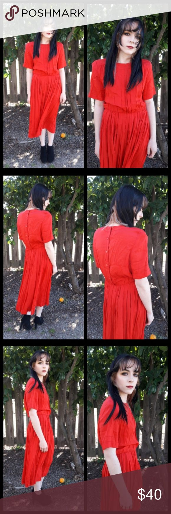 Beautiful vintage 80's pleated red dress! This dress is so Beautiful! Rayon blend so its slightly wrinkled from storage but other than that it's in excellent vintage condition! Dress features a pleated skirt, Structured shoulder, button back and elastic waist. Vintage size 12 petite but please see measurements for proper fit-  Pit to pit: 18 inches  Waist: 12 to 15 inches  Hip: free Length: 46 inches   All measurements taken lying flat 💖 Vintage Dresses Midi