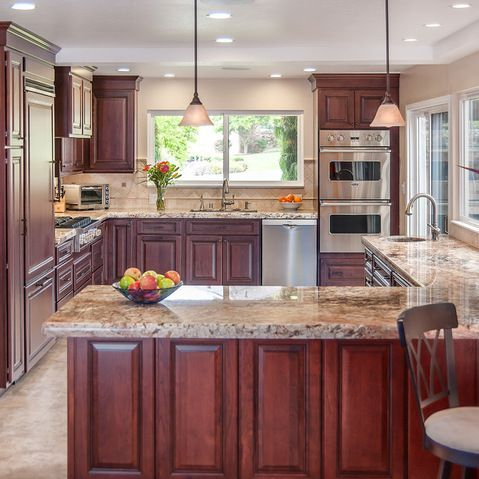 Traditional Kitchen Design Ideas, Pictures, Remodel and Decor - Glazed cherry cabinets, like how they look with the countertop and the lighting.
