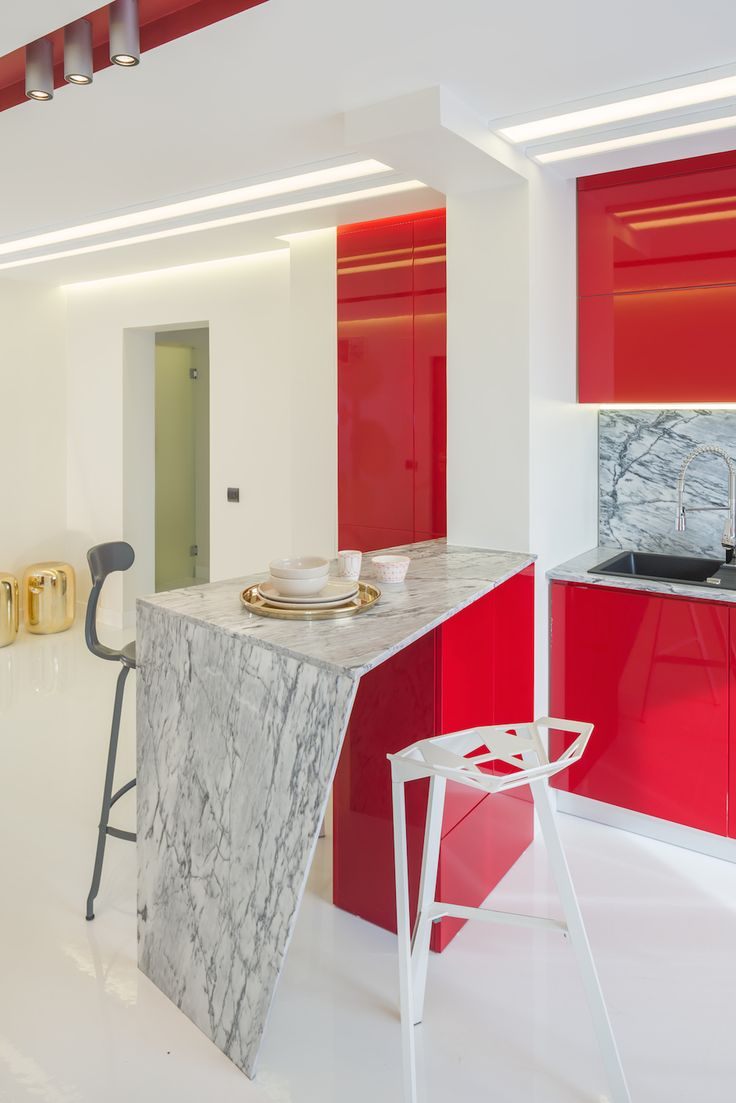 minimalist kitchen with marble countertop, fronts from glossy MDF in marsala color, push-to-open systems for doors orders/price offers at: office@liniafurniture.ro