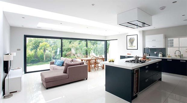 Extending a Victorian semi-detached home: Featuring contemporary sliding doors, sleek kitchen units and a modern colour scheme, this ground-floor extension has transformed a dated house with an impractical layout into a stunning open-plan space.