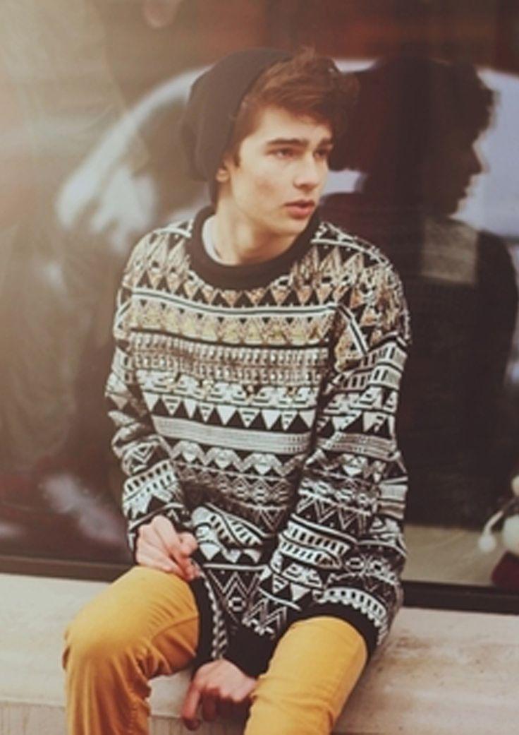 Aztec jumper, beige chinos, beanie, messy brown hair