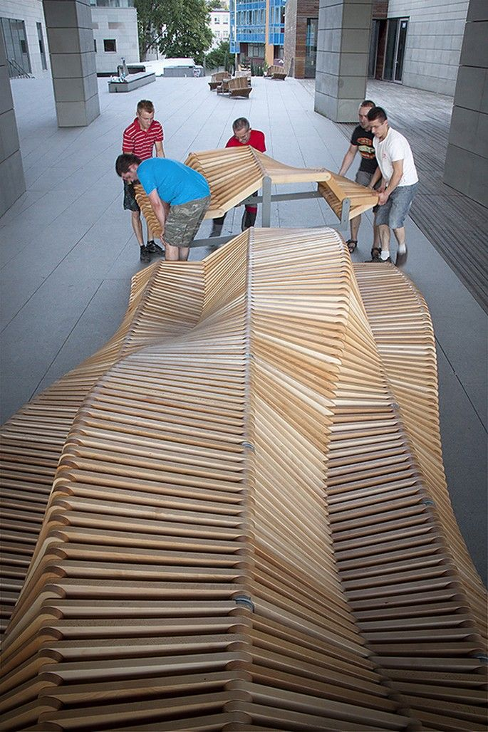Piotr Zuraw's undulating wooden bench | Covet Lounge - Curated Design