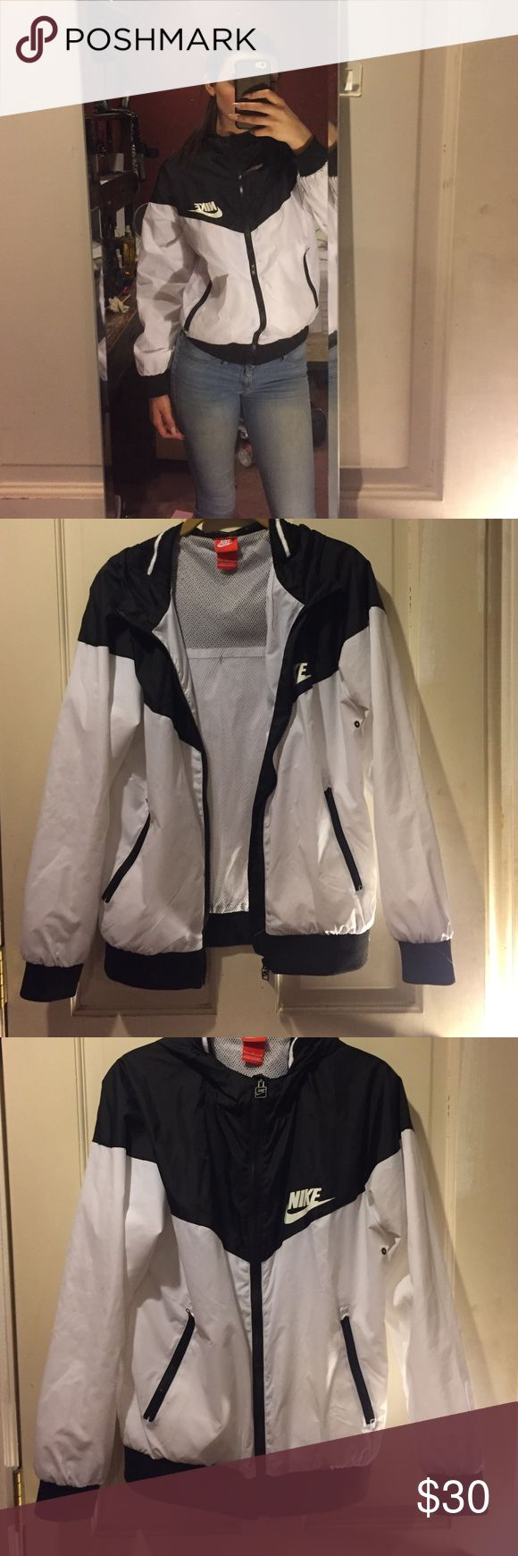 Nike coat This black and white Nike coat is super comfortable and light when worn. Nike Jackets & Coats Puffers