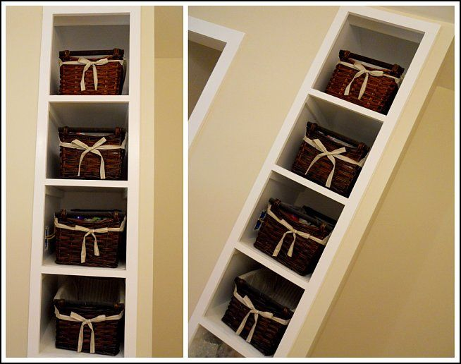 Bathroom storage using built-in shelving for baskets -- so pretty and functional!