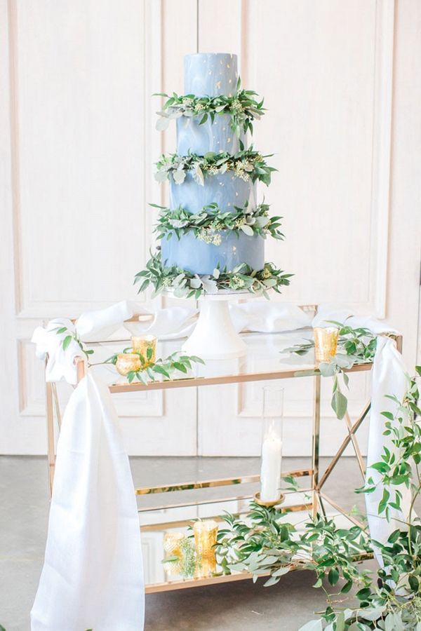 Marbled Wedding Cake with Greenery Garlands Between Layers | Anna Holcombe Photography on @heyweddinglady via @aislesociety