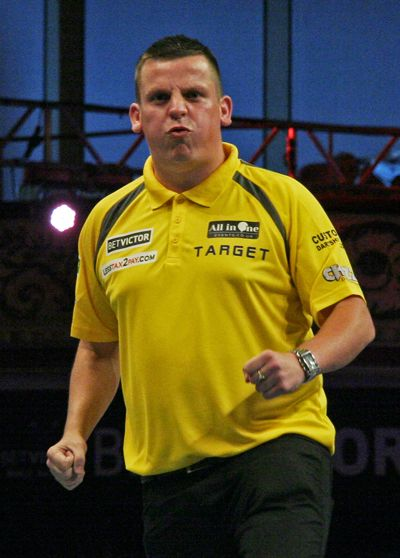 Dave Chisnall celebrates after victory in a hard fought second round game with Jamie Caven