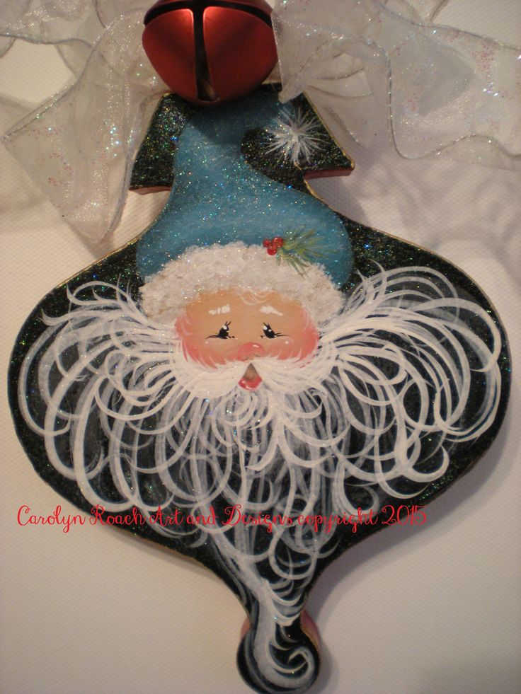 Adorable Santa with a turquoise hat painting pattern, on a paper mach' ornament shape. Available from www.stillslinginpaint.com