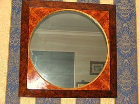 A fine Australian blackwood wall mirror, which are quite rare in colonial furniture. The mirror is veenered with well figured blackwood on pine secondary timber. The inner mount is book jointed huon pine with a imported ebony stringing, the mirror retaining it's original thick glass plate. Tasmanian, circa 1850.