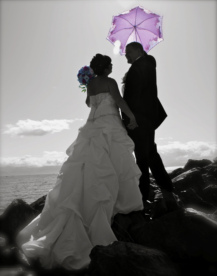 Beach wedding photo in black and white with color accent