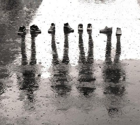 Shadow picture with just shoes and rain