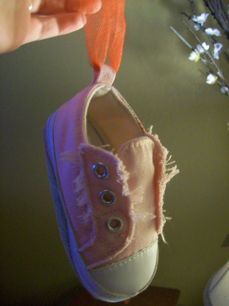 turn baby's first shoe into a sentimental christmas ornament! write the year on the bottom! Somthing to do with her old little shoes besides putting them in a box.