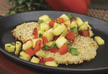 Coconut Almond Tilapia with a Peppered Pineapple Salsa. The crunchy crust  topped with a sweet salsa is perfection!