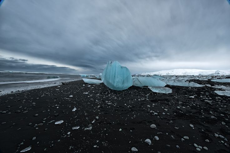 Ice beach, Iceland | Huge icebergs from Vatnajokull, Iceland's largest glacier, drop into Jökulsárlón and slowly make their way out to sea where they are pounded by the heavy surf. The remains of some of the icebergs tumble up onto the black sand beaches
