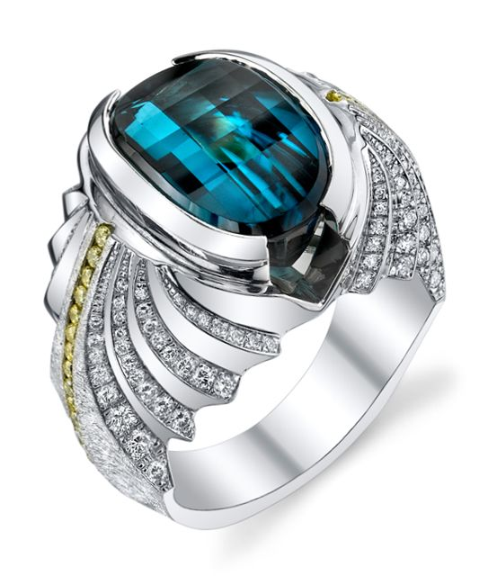 Platinum gents ring with brushed finish, featuring a 11.54ct diamond back cut indicolite blue tourmaline, 0.54ctw of yellow diamonds, and 1.04ctw of white diamonds.