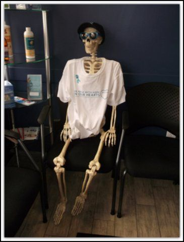 Meet Ralph. He is a skeleton that has been on display in one of our local chiropractor's office since Halloween. One of our committee members decided he needed some beautiful attire! We couldn't agree more!