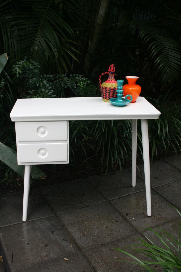 White retro desk matched with Italian glassware, ceramics and Spanish woven vino bottle.