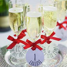 Champagne glasses with round name tags | Clever way to decorate glasses | Tesco Living