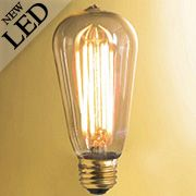 Vintage Style Tapered Medium Base LED Filament Bulb - 4W (item #R-010BR-776501). This energy saving Edison-inspired LED bulb is a Steampunk favorite. Amber glass and 2200 K combine to offer a warm light, similar to that of incandescent bulbs. Suited for both traditional and contemporary decors, its intricate filament makes it an ideal choice for exposed bulb fixtures, both indoor or out. $17.89