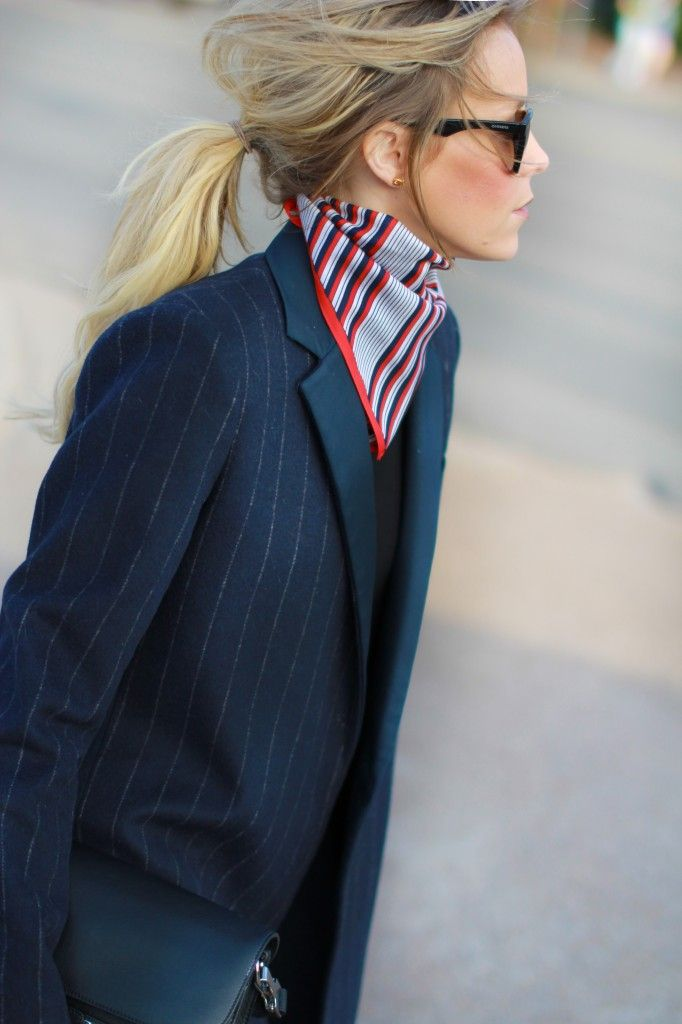 Printed handkerchief and striped navy blazer.