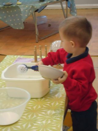 nursery children washing up after self service snack #abcdoes #eyfs