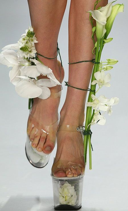 Constanze Gonzalez and Paul Scherer 2009 runway show: flower vase shoes with cala lilies and orchids...