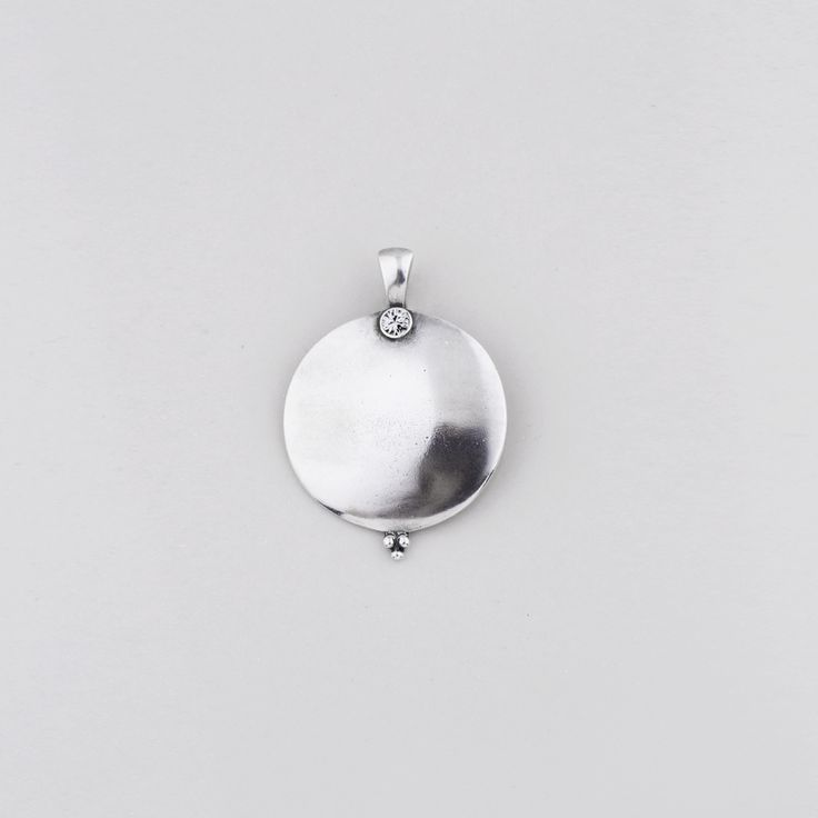 EN1226 Large disc #pendant in burnished #silver with a classic #Swarovski #crystal encrusted clasp - www.miglio.com