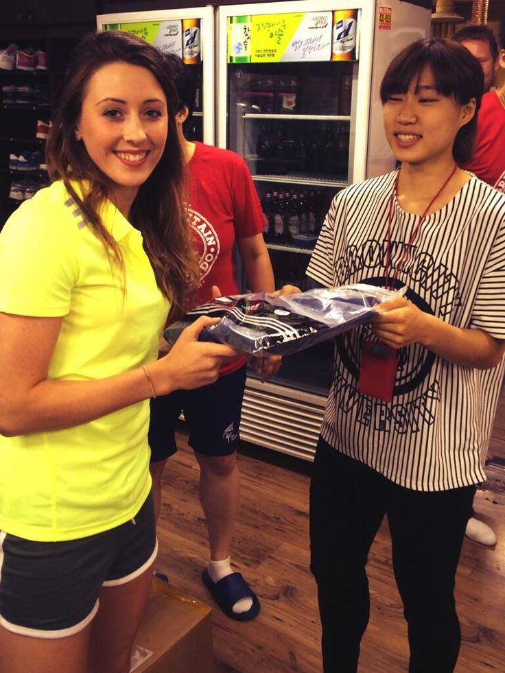 Jade Jones receives a GB Taekwondo and KNSU branded top to symbolise our continued collaboration