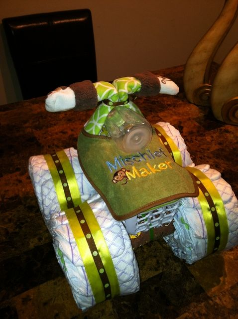 Diaper Trike at a Monkey Baby Shower #monkey #babyshower  I AM GOING TO DO THIS   !  FANTASTIC,  i have done the diaper cake before........love it !